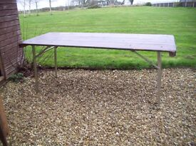 Rectangular folding pine table 183cms long 77 cms wide