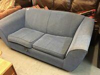 A BLUE FABRIC SOFA BED