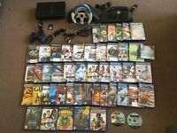 PS2 PlayStation 2 console with wheel and a lot of games