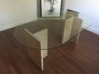 Glass dining table with marble stand.