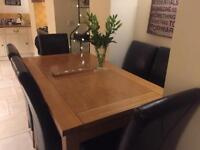 Solid oak extendable dining table & 8 dark brown full back leather chairs Gardiner Haskins