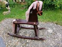 Old fashioned wooden rocking horse kids toy