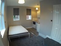 BEDSIT.. small self contained room with compact kitchen area and en suite shower/wc