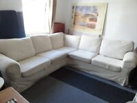Corner Sofa (Bed) with Cream Colour Pattern Covers (Ikea)