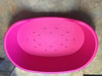 Hard plastic pink dog bed