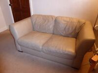 Beige leather two seater sofa