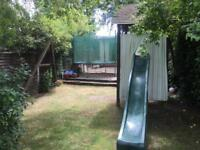 Wooden swings and slide set