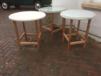 three round coffee tables - two with glass tops