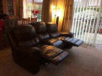 Brown leather reclining three seater sofa and chair.