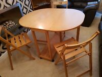Folding dinner table and 3 matching chairs. Good condition