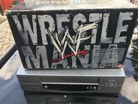 box set of wrestle mania tapes and vhs video player to play them on