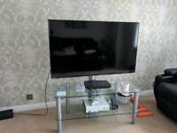 Glass TV stand with movable bracket