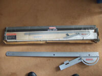 Specialist steel ruler with angle attachment.