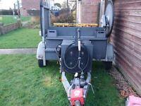 Wheelie bin cleaning machine