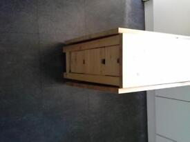 Large solid wooden extendable table with drawers.