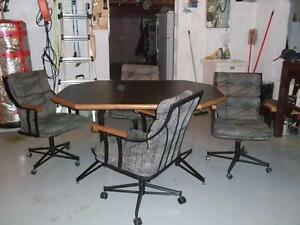 Table with 4 swivel chairs