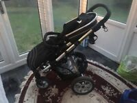 Pushchair (Suitable from birth), used for less than a year. Includes rain cover and footmuff.