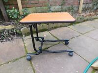 OVER BED TABLE IS BRAND NEW FULLY ADJUSTABLE CAN DELIVER