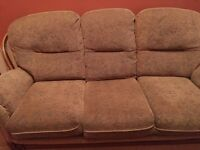 Selling two, brown, three seater sofas and a Wooden Cabinet