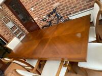 Very Large Heavy Louis dining table with 8 Chairs.