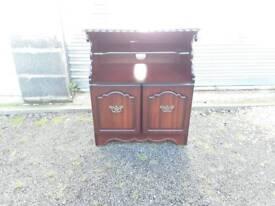 Dark wood tv stand / lounge unit
