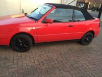 Red electric roof Golf convertible