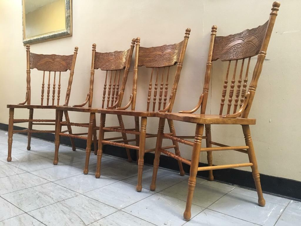 Set Of 4 solid dining chairs Hand Carved £100