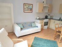 Impressive two double bedded flat in well kept stair and well maintained garden with outhouse