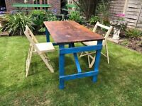 Vintage folding trestle table and two folding wooden chairs, ideal pop up patio furniture
