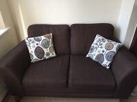 Brown 2 seater sofa.