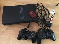 PlayStation 2, 2 Controllers, 2 Memory Cards, Guitar Hero 3 & selection of games