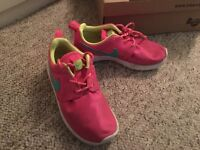 Girls pink and blue Nike trainers size 11.5