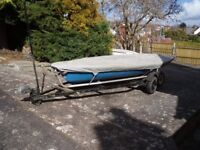 Laser sailng dinghy for sale, includes launching trolley and road trailer.