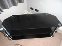 MODERN THREE TIER BLACK GLASS TV STAND WITH CHROME LEGS IN GOOD CONDITION
