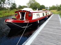 House boat wibe beam liveaboard canal barge moored just outside Glasgow