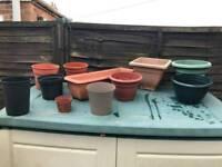 11 various sized plastic garden plant pots