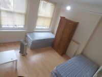 1 min Aldgate east E1 huge double and single rooms to let above shop in E1