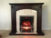 Dark Wood Fire Surround and glowing flame fan heater