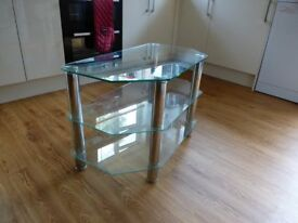 Tempered Glass TV stand with Chrome Legs in excellent condition