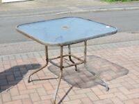 Square glass and steel patio table