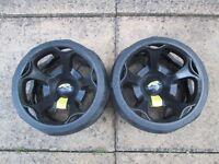 pair of powakaddy winter wheels.