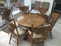 OAK EXTENDING TABLE , 4 Carved padded chairs + 2 Carved padded Carvers