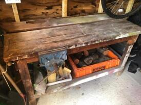 Old solid work bench with vice