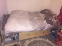 Two single beds with drawers and mattress