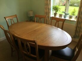 Solid Oak Oval Dining Table and six black leather chairs