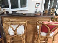 Wooden bar, mahogany top, bamboo front. Two bar stools, bamboo.