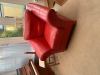 2 red leather armchairs