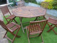large teak garden table +6 folding chairs