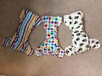 Preloved Reusable Nappies - 6 Ella's house Bumhuggers and 3 blueberry wraps.