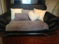 Two Matching Faux Leather Sofas Can be sold separately